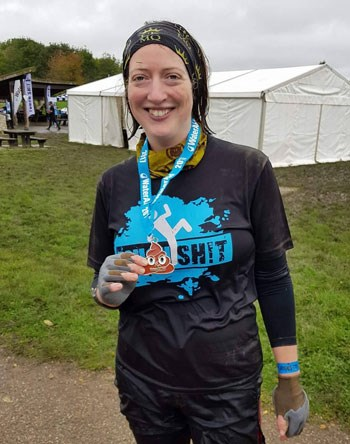 Jenny from Charity Car with her poo emoji medal from WaterAid