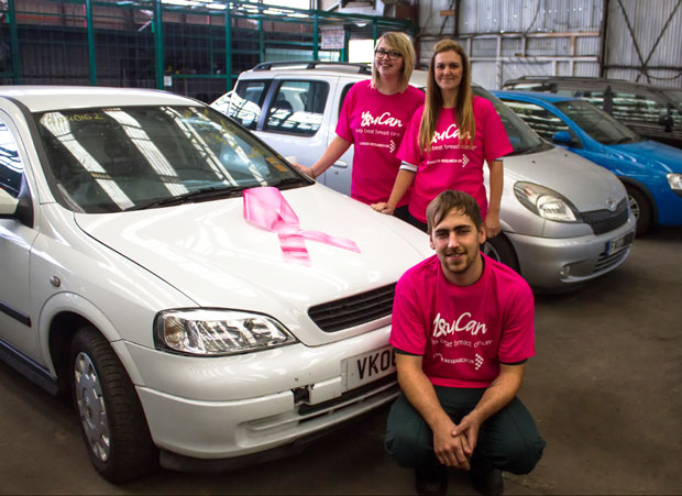 Charity Car Team with donated car for Breast Cancer Awareness Month