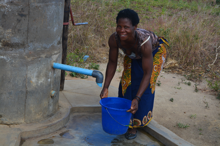 Woman using a water pump