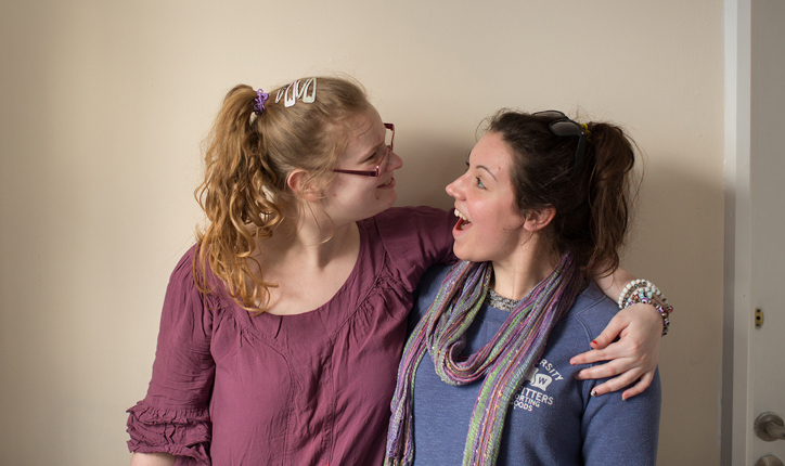 Two women hugging and smiling - National Autistic Society.